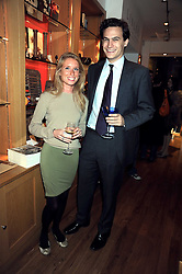 FLAVIA COPPACK and OLIVER LIS at the Linley Christmas party at their store at 60 Pimlico Road, London on 19th November 2008.