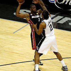 Jun 16, 2013; San Antonio, TX, USA; Miami Heat shooting guard Dwyane Wade (3) passes against San Antonio Spurs small forward Kawhi Leonard (2) during the first quarter of game five in the 2013 NBA Finals at the AT&T Center. Mandatory Credit: Derick E. Hingle-USA TODAY Sports