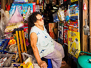 20 MARCH 2017 - BANGKOK, THAILAND: A woman who owns a small shop in a tin shack in Pom Mahakan. She says she has not been given an eviction order yet, but that all of her customers, the families that used to buy candy and snacks from her, have been evicted from the old fort. The final evictions of the remaining families in Pom Mahakan, a slum community in a 19th century fort in Bangkok, have started. City officials are moving the residents out of the fort. NGOs and historic preservation organizations protested the city's action but city officials did not relent and started evicting the remaining families in early March.               PHOTO BY JACK KURTZ