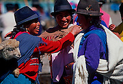 ECUADOR, MARKETS, CRAFTS Saquisili market, indian women talking