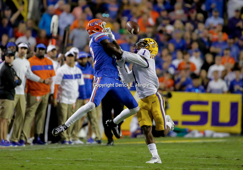 Oct 12, 2019; Baton Rouge, LA, USA; LSU Tigers cornerback Kristian Fulton (1) breaks up a pass to Florida Gators running back Lamical Perine (2) during the first half at Tiger Stadium. Mandatory Credit: Derick E. Hingle-USA TODAY Sports