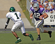 Kansas State quarterback Allan Evridge (12) rushes up field against pressure from North Texas defensive back Gary Oubre (1) during the second half.  Kansas State defeated the Mean Green of North Texas 54-7 at KSU Stadium in Manhattan, Kansas on September 24, 2005.