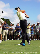 Fourteen year old Michelle Wie tees of while fans observe during action at The 2004 Pearl Open in Aiea, Hawaii.