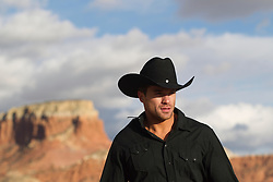 very good looking cowboy outdoors in a mountain range in Abiquiu, New Mexico