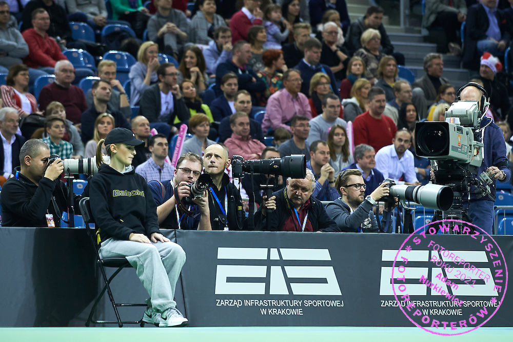 (L-R) Photographer Tomasz Jagodzinski (Superexpres Daily) and line umpire and Jan Graczynski (East News Agency) and Piotr Hawalej (Wrofoto Agency) and Marek Lasyk (Reporter Agency) and Michal Stawowiak (Przeglad Sportowy Daily) and cameraman of TV Polsat official broadcaster during First Day of the Fed Cup / World Group 1st round tennis match between Poland and Russia at Tauron Krakow Arena on February 7, 2015 in Cracow, Poland.<br /> <br /> Poland, Cracow, February 7, 2015<br /> <br /> Picture also available in RAW (NEF) or TIFF format on special request.<br /> <br /> For editorial use only. Any commercial or promotional use requires permission.<br /> <br /> Adam Nurkiewicz declares that he has no rights to the image of people at the photographs of his authorship.<br /> <br /> Mandatory credit:<br /> Photo by &copy; Adam Nurkiewicz / Mediasport