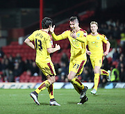 Burnley midfielder Joey Barton celebrating scoring second goal from free kick with Burnley defender Stephen Ward during the Sky Bet Championship match between Brentford and Burnley at Griffin Park, London, England on 15 January 2016. Photo by Matthew Redman.