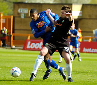 Photo: Ed Godden.<br />Barnet v Stockport County. Coca Cola League 2. 29/04/2006. Tes Bramble (L), tussles with Stockport's Paul Warhurst.