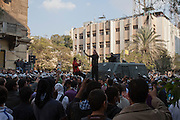 An Egyptian security force officer attempts to dialog with a crowd of protestors atop a riot police truck during a brief cease-fire that took place in between demonstrations November 21, 2011 near Tahrir square  in central Cairo, Egypt. The cease-fire held for about 15 minutes before returning to pitched street battles. Thousands of protestors demanding the military cede power to a civilian authority clashed with Egyptian security forces for a third straight day in Cairo, with hundreds injured and at least 24 protestors killed.  (Photo by Scott Nelson)