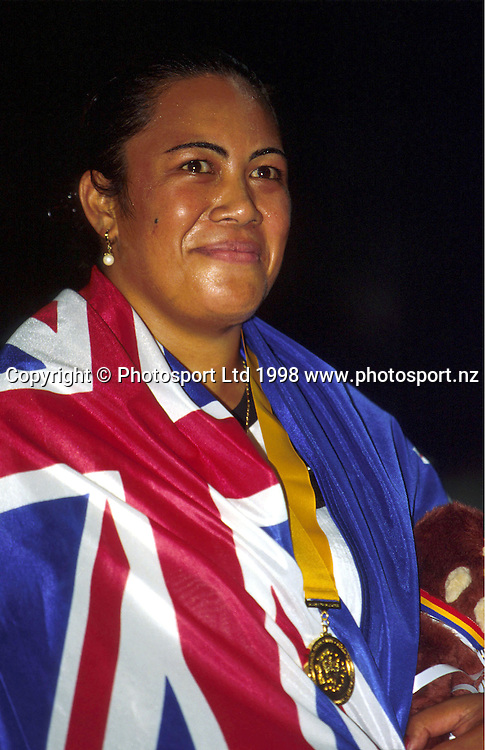 Beatrice Faumuina celebrates with her medal and the New Zealand flag at the Commonwealth Games, Kuala Lumpur, 1998. Photo: Scott Barbour/PHOTOSPORT