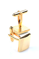 Gold cuff links on white background