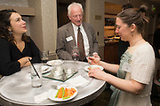 Director of the Cutler Scholars Senior Mentor Dinner, Dr. Herman H. Hill, talks with Kara Frisina and her mentor Mary Nally. © Ohio University / Photo by Olivia Wallace