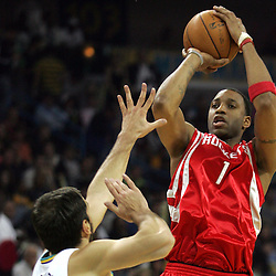 Houston Rockets guard Tracy McGrady #1 shoots over New Orleans Hornets forward Peja Stojakovic (L) in the first quarter of their NBA game on March 19, 2008 at the New Orleans Arena in New Orleans, Louisiana.