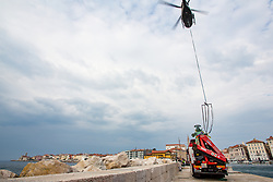 After two months of restoration, the Statue of Archangel Michael, made of copper plate, returned to Piran. The image shows a helicopter lift off the statue of Archangel Michael of the truck and in background view St. George's Parish Church and Cape Madona, on October 15, 2018 in Piran, Slovenia. Photo by Matic Klansek Velej / Sportida