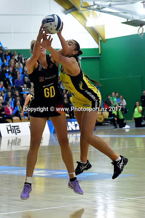 Magic's Monica Falkner (L) takes a pass with Pulse's Tiana Metuarau during the ANZ Premiership netball match between the Pulse and Magic at the Central Energy Trust Arena in Palmerston North on Monday the 5th of June 2017. Copyright Photo by Marty Melville / www.Photosport.nz