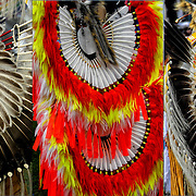 Triptych of Native American fancy dancers bustle regalia at the Thunderbird Powwow at the Queens County Farm Museum.<br />
