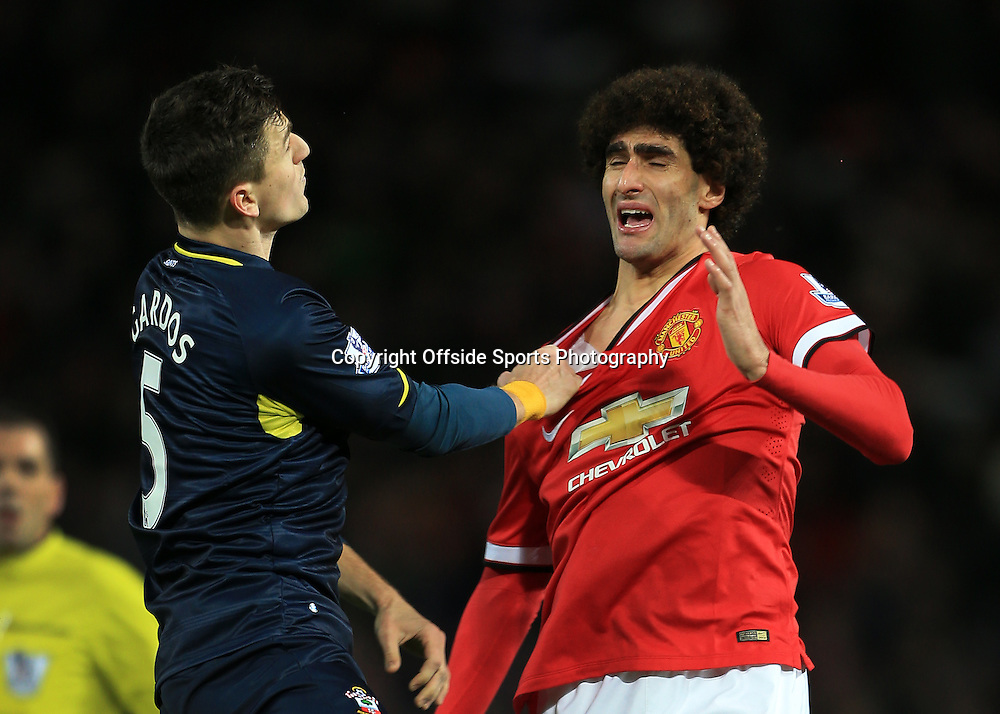 11th January 2015 - Barclays Premier League - Manchester United v Southampton - Marouane Fellaini of Man Utd winces as Florin Gardos of Southampton challenges - Photo: Simon Stacpoole / Offside.