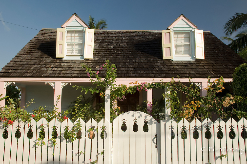 A traditional clapboard house with pickett fence in Dunmore Town, Harbour Island, The Bahamas