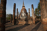 Wat Sa Si at Sukhothai Historical Park is located to the northwest of Wat Mahathat. This ancient temple is situated on an island in the middle of Traphang Trakuan pond.  It's a simple, classic Sukhothai-style wát containing a large Buddha, one chedi and the columns of the ruined wihan.  The Sri Lankan bell shaped stupas here indicate the Sinhalese influence in the Sukhothai art style.