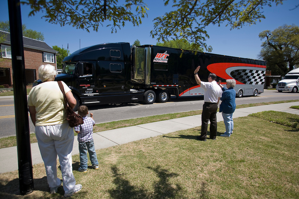 Rockingham, N.C., residents greet ARCA series race car haulers on Friday, April 17, 2009, as they parade through town before returning to the Rockingham Speedway for the Carolina 200 on Sunday.