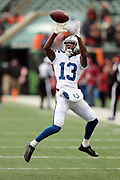 Indianapolis Colts wide receiver T.Y. Hilton (13) leaps and catches a pass while warming up before the 2017 NFL week 8 regular season football game against the Cincinnati Bengals, Sunday, Oct. 29, 2017 in Cincinnati. The Bengals won the game 24-23. (©Paul Anthony Spinelli)