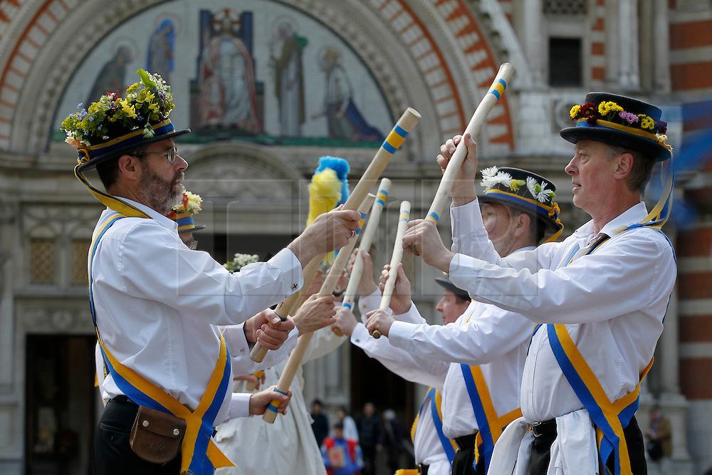© Licensed to London News Pictures. 12/05/2012, London, UK.  Yateley Morris Men dance outside the Westminster Cathedral in London as Morris men from around the country gather in London for a Westminster Morris Men Day of Dance, Saturday, May 12, 2012. Photo credit : Sang Tan/LNP