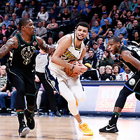01 April 2018: Denver Nuggets guard Jamal Murray (27) drives past Milwaukee Bucks guard Eric Bledsoe (6) during the Denver Nuggets 128-125 victory over the Milwaukee Bucks, at the Pepsi Center, Denver, Colorado, USA.