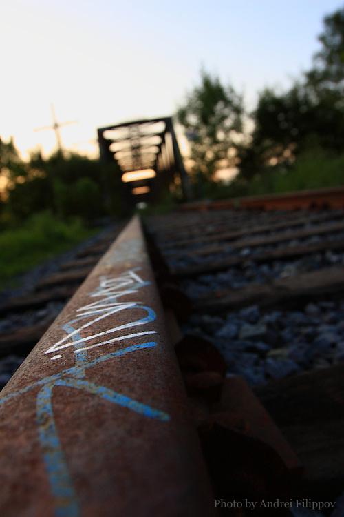 Graffiti on the abandoned railroad track leading to the bridge, Ottawa ON Canada, August 6, 2009.