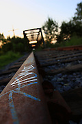 Graffiti on the abandoned railroad track leading to the bridge, Ottawa ON Canada, August 6, 2009.