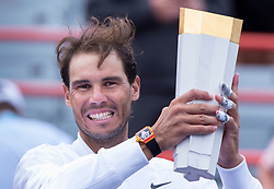 Rafael Nadal, of Spain, holds up the trophy after beating Daniil Medvedev, of Russia, in the final at the Rogers Cup tennis tournament, in Montreal on Sunday, Aug. 11, 2019. Photo by Paul Chiasson/CP/ABACAPRESS.COM