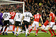 Nottingham Forest defender Yohan Benalouane (29) slides in at the back post for an early Forest goal 1-0 during the EFL Sky Bet Championship match between Nottingham Forest and Derby County at the City Ground, Nottingham, England on 25 February 2019.