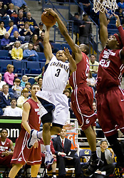 February 13, 2010; Berkeley, CA, USA;  Washington State Cougars guard Marcus Capers (0) blocks a shot from California Golden Bears guard Jerome Randle (3) during the first half at the Haas Pavilion.  California defeated Washington State 86-70.