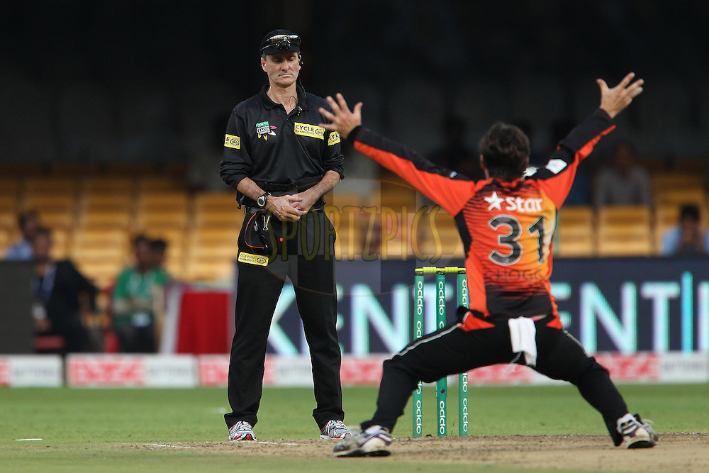 Umpire Billy Bowden is unmoved as Brad HOGG of the Perth Scorchers appeals for the wicket of Saad NASEEM of the Lahore Lions during match 19 of the Oppo Champions League Twenty20 between the Perth Scorchers and the Lahore Lions held at the M. Chinnaswamy Stadium, Bengaluru, India on the 30th September 2014<br /> <br /> Photo by:  Ron Gaunt / Sportzpics/ CLT20<br /> <br /> <br /> Image use is subject to the terms and conditions as laid out by the BCCI/ CLT20.  The terms and conditions can be downloaded here:<br /> <br /> http://sportzpics.photoshelter.com/gallery/CLT20-Image-Terms-and-Conditions-2014/G0000IfNJn535VPU/C0000QhhKadWcjYs