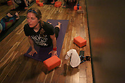NEW YORK CITY, NEW YORK, MARCH 30, 2016. Caryn Havlik participates in Metal Bones Yoga as strength training for her drumming. The class takes place at 6:30 p.m. on Wednesdays at The Cobra Club in Bushwick, Brooklyn. 03/30/2016. Photo by Donna M. Airoldi/NYC News Service