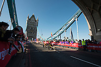 Marcel Hug of Switzerland followed by David Weir of the UK<br /> Wheelchair Men at Tower Bridge<br /> The Virgin Money London Marathon 2014<br /> 13 April 2014<br /> Photo: David Levenson/Virgin Money London Marathon<br /> media@london-marathon.co.uk