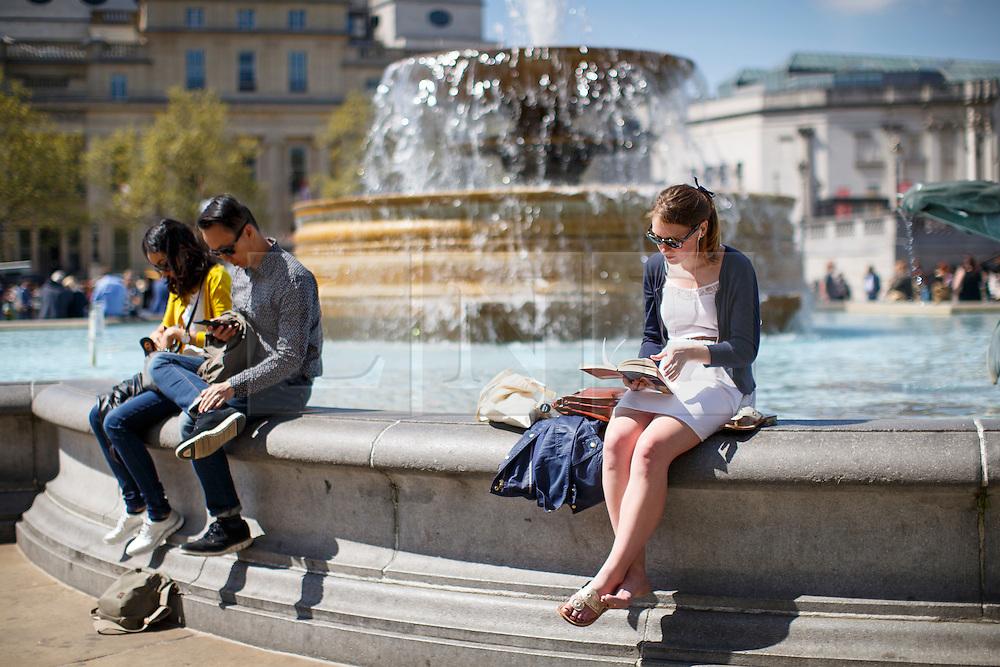 © Licensed to London News Pictures. 04/05/2016. London, UK. People enjoying sunshine and warm weather in Trafalgar Square, London on Wednesday, 4 May 2016. Photo credit: Tolga Akmen/LNP