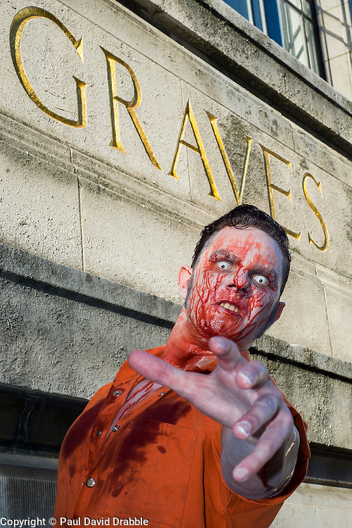 Slingshots Top Zomboss Alex Noble, outside Graves Art Gallery in Sheffield on Tuesday evening ahead of the game 2.8 Hours Later which reaches the city in August <br /> <br /> 30 June 2015<br />  Image &copy; Paul David Drabble <br />  www.pauldaviddrabble.co.uk