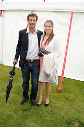 JOHN PAUL CLARKIN and his wife NINA at the 2013 Cartier Queens Cup Polo at Guards Polo Club, Berkshire on 16th June 2013.