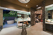 Bathroom with artwork of freestanding bath in California home