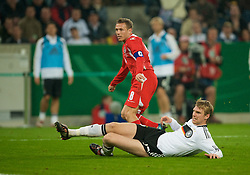 MONCHENGLADBACH, GERMANY - Wednesday, October 15, 2008: Wales' captain Craig Bellamy sees his shot saved as Germany's Per Mertesacker closes in during the 2010 FIFA World Cup South Africa Qualifying Group 4 match at the Borussia-Park Stadium. (Photo by David Rawcliffe/Propaganda)