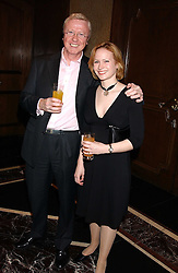 TV producer MIKE HOLLINGSWORTH former husband of Anne Diamond and MISS KIMBERLEY STEWART-MOLE  at the Holders Season Barbados Comes to London night at The Four Seasons Hotel, Hamilton Place, London on 3rd February 2006.<br /><br />NON EXCLUSIVE - WORLD RIGHTS