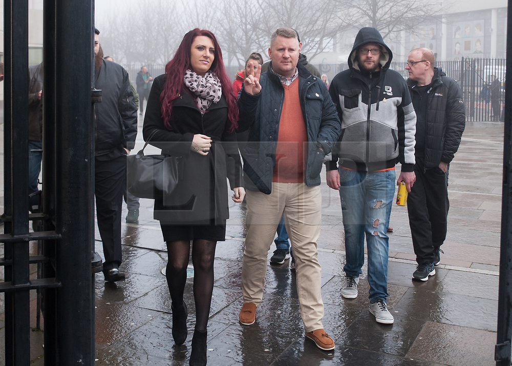 """© Licensed to London News Pictures. 10/1/2018. Belfast, UK. Britain First's leader Paul Golding (3L) with deputy leader Jayda Fransen (2L) arrives at court to make his first appearance after being charged with using """"threatening, abusive, insulting words or behaviour"""" following a speech he gave at a rally organised by Independent Belfast City Councillor Jolene Bunting last year. Ms Fransen has been criticised after appearing in a video showing her sitting in robes in the Lord Mayor's chair inside Belfast City Hall. The council are investigating.   Photo credit: John Rymer/LNP"""