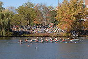 Boston, USA, Collegiate Women's Eights, pass, the crowds gathered by Cambridge Boat Club, at the Head of the Charles Race, Charles River, Cambridge,  Massachusetts. Saturday  21/10/2007 [Mandatory Credit Peter Spurrier/Intersport Images]..... , Rowing Course; Charles River. Boston. USA Cambridge Boat House