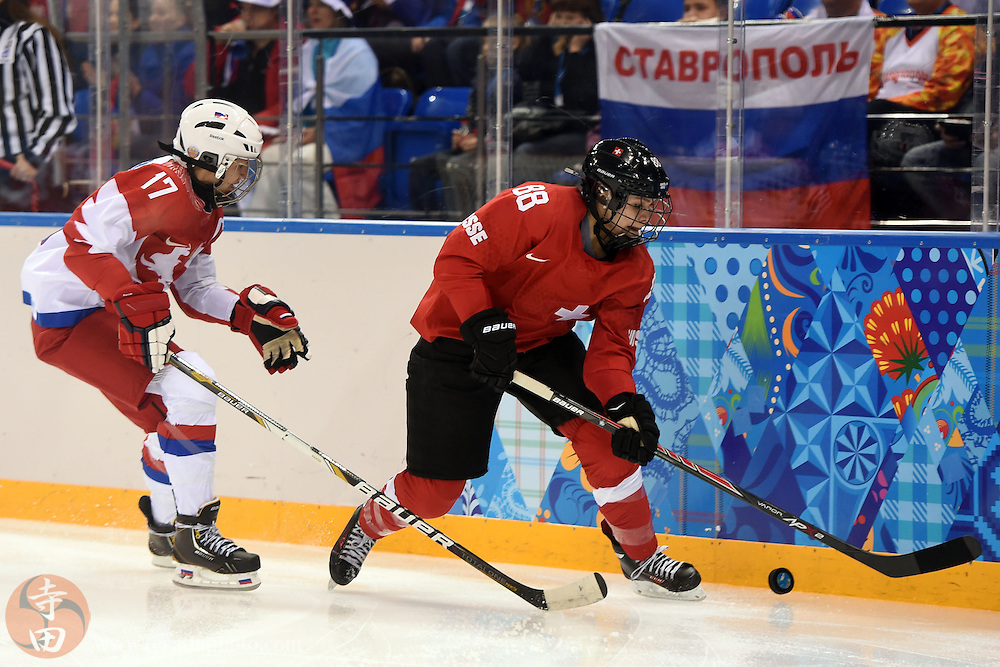 Feb 15, 2014; Sochi, RUSSIA; Switzerland forward Phoebe Stanz (88) skates with the puck as Russia forward Yekaterina Smolentseva (17) defends in a women's quarterfinals ice hockey game during the Sochi 2014 Olympic Winter Games at Shayba Arena.