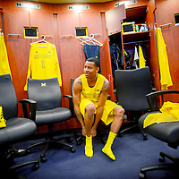 ANN ARBOR, MICHIGAN -- February 5, 2013 -- University of Michigan's Trey Burke laces up on game day to take on rival Ohio State University in Ann Arbor, Michigan.  The Wolverines won 76-74 in overtime.   (PHOTO / CHIP LITHERLAND)