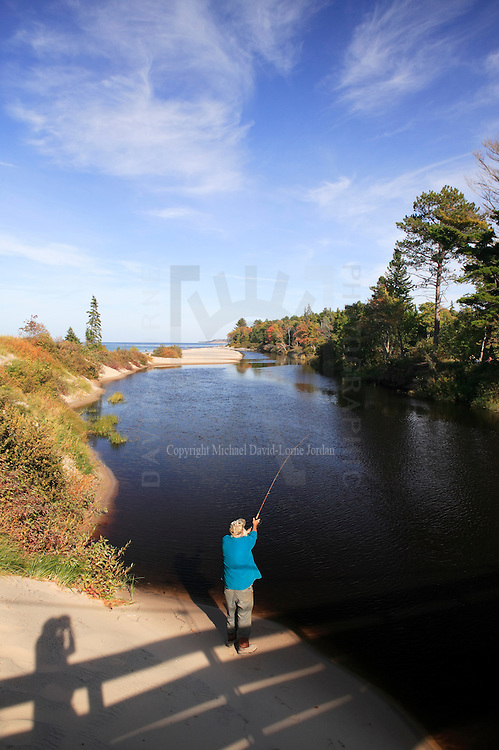 Man fishing on the Two Hearter River, Two Hearted River, Michigan's Upper Peninsula.