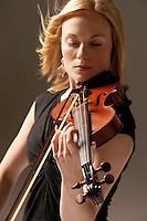 Woman Playing Violin close up