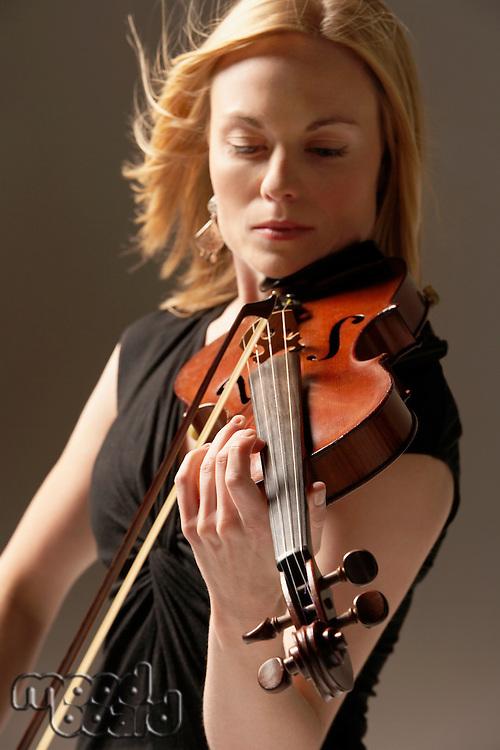 Woman Playing Violin close up