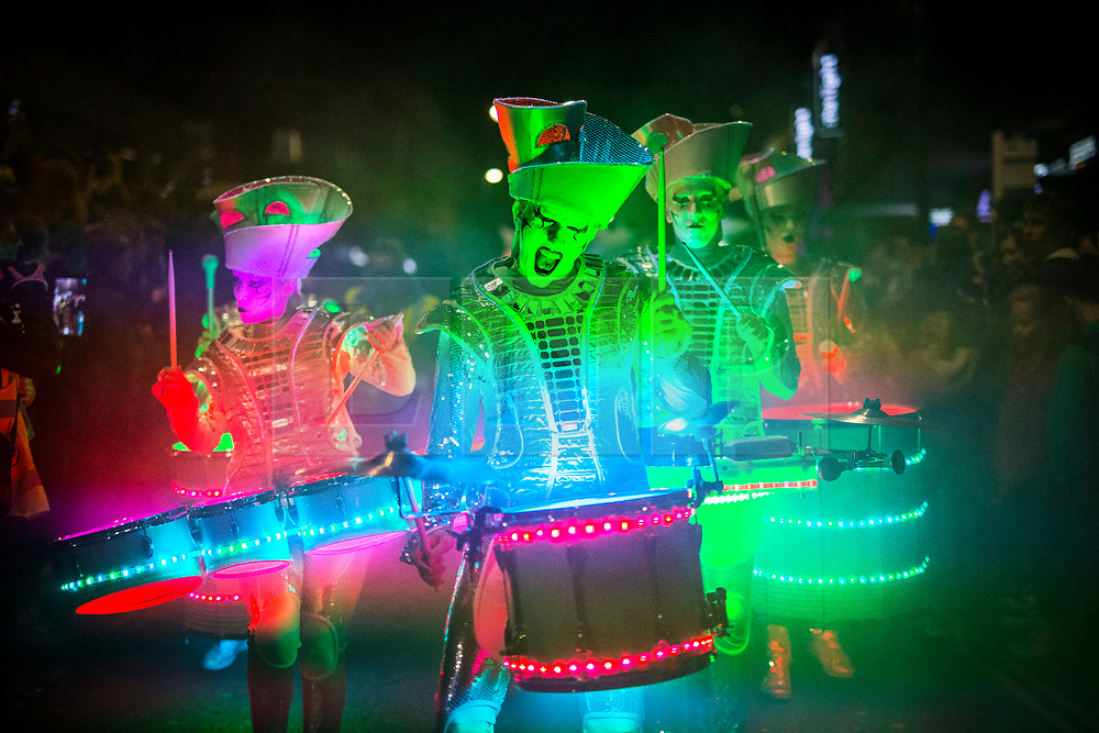 © Licensed to London News Pictures. 05/10/2017. Leeds UK. LED Drum group Sparks lead the Leeds Light Night Carnival parade through Leeds city centre on the first night of the Leeds Light Night event which runs until 6th October. Leeds Light Night is an annual free multi arts festival that takes place every October in Leeds City centre, starting in 2005, the event has grown and is now enjoyed by 80,000 people. Photo credit: Andrew McCaren/LNP