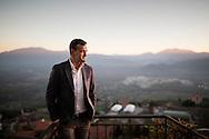 Viggiano, Italia - Amedeo Cicala, sindaco di Viggiano (Basilicata), ritratto sul belevedere del paese. Sullo sfondo il centro olli della Eni.<br /> Ph. Roberto Salomone