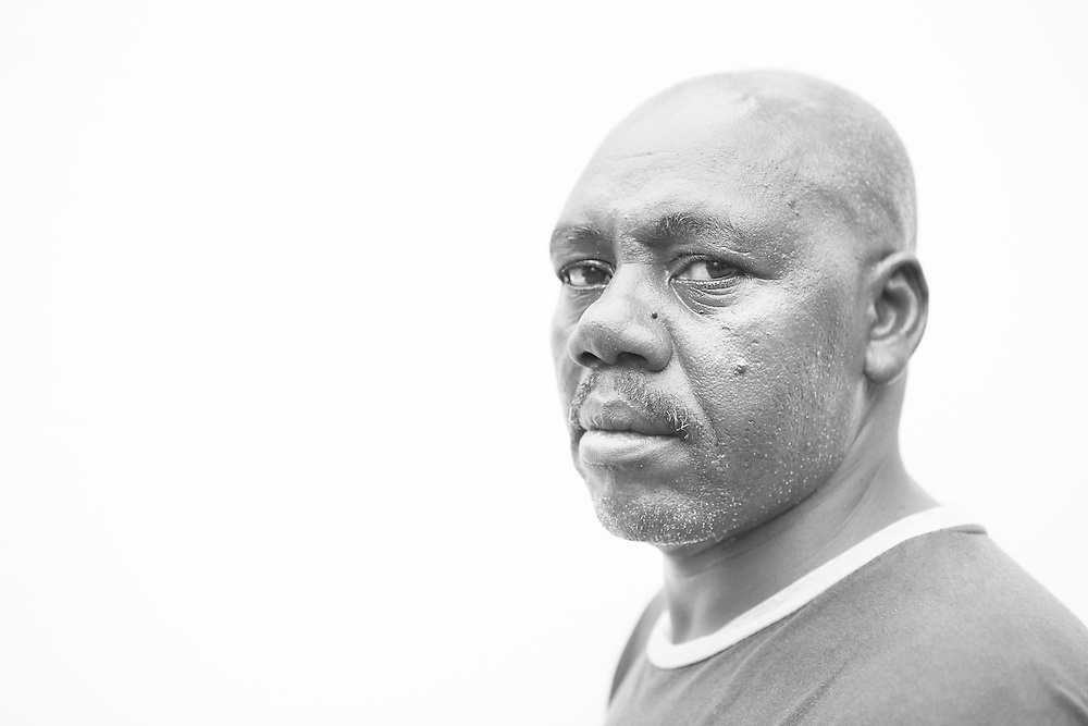 Black and white portrait photograph of African American father angry and in fear